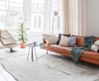 Shop the look: cognac-coloured sofa in a white interior