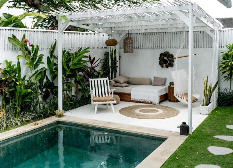 Wegzwijmelen: 9x prachtige tuinen met een zwembad